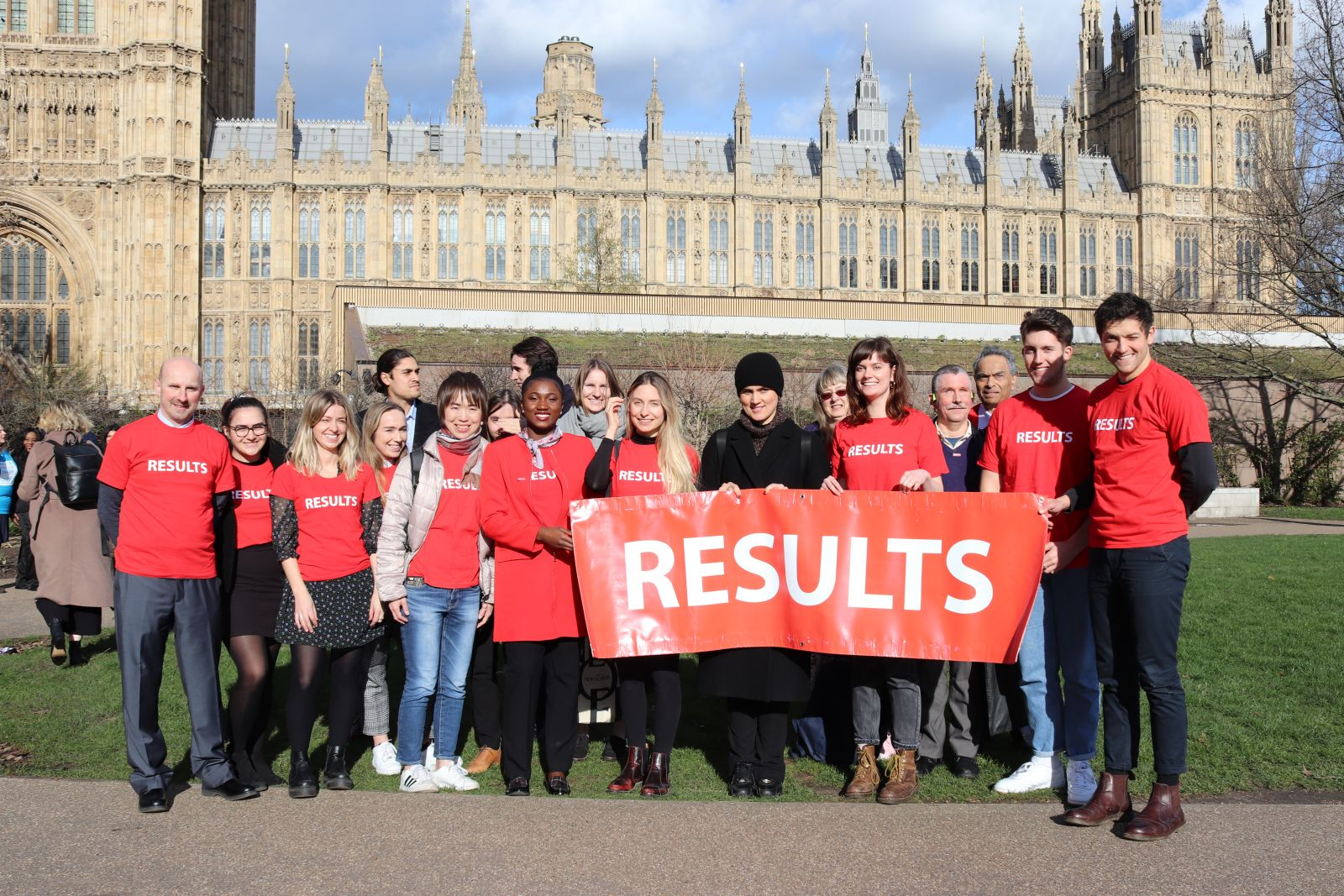 RESULTS advocates stand with banner outside the Houses of Parliament